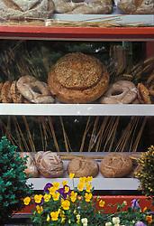 Bakery pastry shop window, breads donuts flowers.