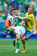 Paris, France - 2016 June 13: (L) Robbie Keane of Republic of Ireland fights for the ball with (R) Sebastian Larsson of Sweden while Sweden v Ireland match during Soccer European Championships UEFA EURO 2016 at Stade de France on June 13, 2016 in Paris, France.<br /> <br /> Adam Nurkiewicz declares that he has no rights to the image of people at the photographs of his authorship.<br /> <br /> Picture also available in RAW (NEF) or TIFF format on special request.<br /> <br /> Any editorial, commercial or promotional use requires written permission from the author of image.<br /> <br /> Mandatory credit:<br /> Photo by © Adam Nurkiewicz