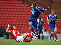 Photo: Rich Eaton.<br /> <br /> Barnsley v Cardiff City. Coca Cola Championship.<br /> <br /> 05/08/2006. Cardiffs Riccy Scimeca is tackled