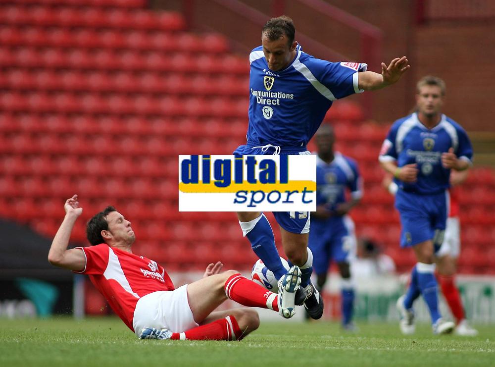 Photo: Rich Eaton.<br /> <br /> Barnsley v Cardiff City. Coca Cola Championship.<br /> <br /> 05/08/2006. Cardiffs Riccy Scimeca is tackled
