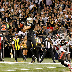 December 16, 2012; New Orleans, LA, USA; New Orleans Saints wide receiver Lance Moore (16) catches a touchdown over Tampa Bay Buccaneers free safety Ahmad Black (43) during the first half of a game at the Mercedes-Benz Superdome. The Saints defeated the Buccaneers 41-0. Mandatory Credit: Derick E. Hingle-USA TODAY Sports