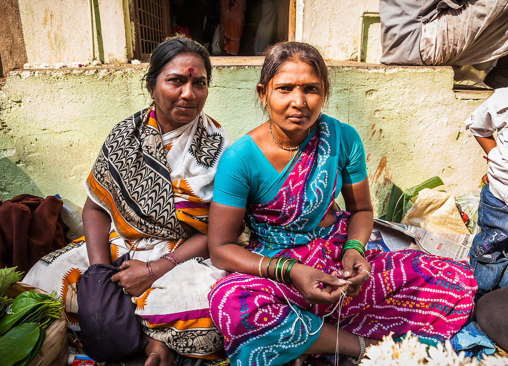 Two women in a flower market, Pune, India.