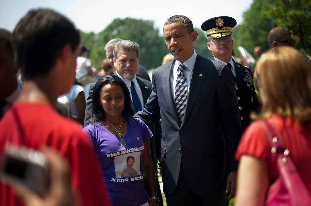 President BARACK OBAMA visits with familes at Arlington National Cemetery's  Section 60 on Memorial Day.