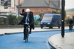 © Licensed to London News Pictures.06/11/2013. London, UK. Mayor of London, Boris Johnson rides his bicycle. London's first segregated section of Barclays Cycle Superhighway has been launched at Stratford High Street.Photo credit : Peter Kollanyi/LNP