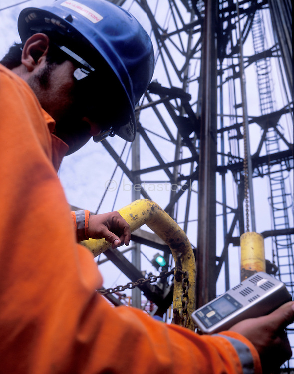 A safety worker checking for gas leaks on an oil platform in the Gulf of Mexico.