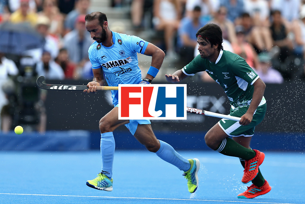 LONDON, ENGLAND - JUNE 18: Ramandeep Singh of India runs past Muhammad Aleem Bilal of Pakistan during the Hero Hockey World League Semi Final match between Pakistan and India at Lee Valley Hockey and Tennis Centre on June 18, 2017 in London, England.  (Photo by Alex Morton/Getty Images)