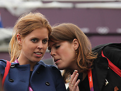 © licensed to London News Pictures. London, UK. 01/08/2012. Princess Beatrice (left) and Princess Eugenie (right) watching Zara Phillips compete at Olympic Equestrian Showjumping at Greenwich Park on August 1, 2012. Photo credit: Russell Marsh/LNP