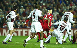 LIVERPOOL, ENGLAND - Tuesday, March 19, 2002: Liverpool's Jari Litmanen (hidden) scores the opening goal against AS Roma  during the UEFA Champions League Group B match at Anfield. (Pic by David Rawcliffe/Propaganda)