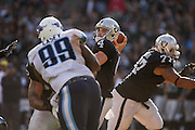 Oakland Raiders quarterback Derek Carr (4) throws the ball against the Tennessee Titans at Oakland Coliseum in Oakland, Calif., on August 26, 2016. (Stan Olszewski/Special to S.F. Examiner)