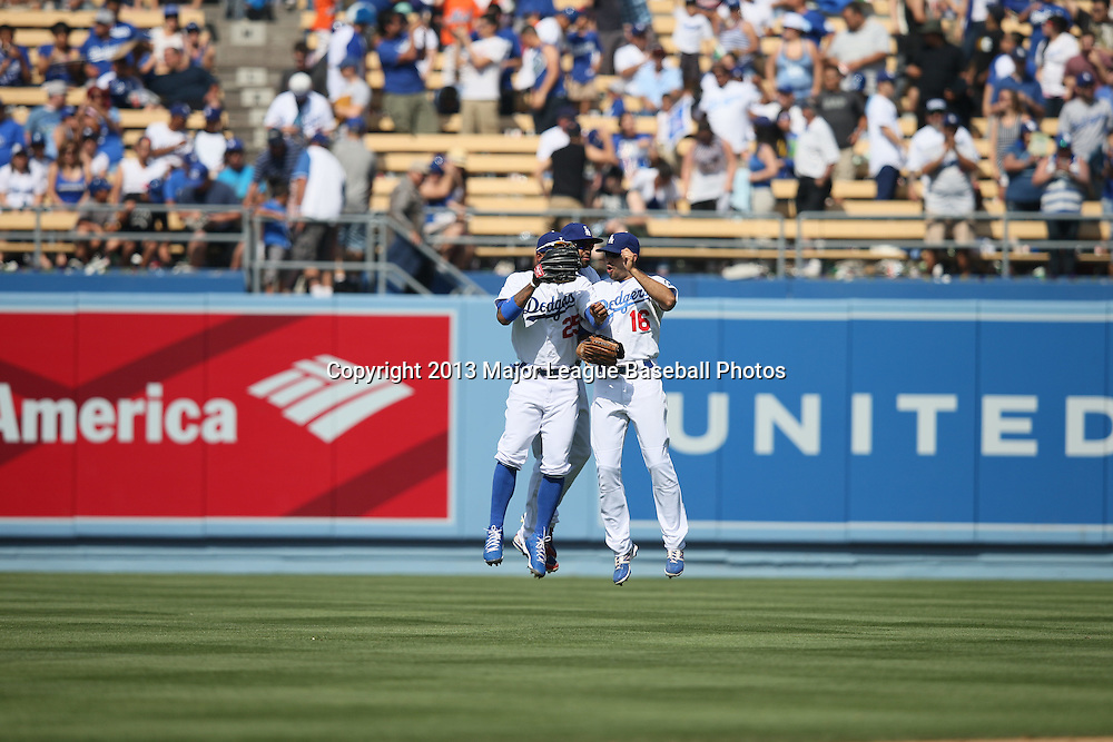 LOS ANGELES, CA - APRIL 28:  Carl Crawford #25 of the Los Angeles Dodgers, Matt Kemp #27 of the Dodgers, and Andre Ethier #16 of the Dodgers leap and celebrate in center field after winning the game against the Milwaukee Brewers on Sunday, April 28, 2013 at Dodger Stadium in Los Angeles, California. The Dodgers won the game 2-0. (Photo by Paul Spinelli/MLB Photos via Getty Images) *** Local Caption *** Carl Crawford;Matt Kemp;Andre Ethier