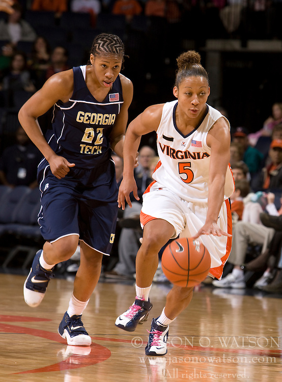Virginia guard Sharnee Zoll (5) dribbles upcourt past Georgia Tech forward Alex Montgomery (22).  The Virginia Cavaliers women's basketball team defeated the Georgia Tech Yellow Jackets 103-101 in double overtime at the University of Virginia's John Paul Jones Arena in Charlottesville, VA on March 2, 2008.