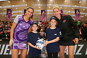 ANZ Future Captains Sylvia Strong aged 9 and Tamsin Wilson aged 9 pose for a photo with Grace Kara of the Stars and Casey Kopua of the Magic prior to the match. 2018 ANZ Premiership netball match, Stars v Magic at Pulman Arena, Auckland, New Zealand. 27 May 2018 © Copyright Photo: Anthony Au-Yeung / www.photosport.nz