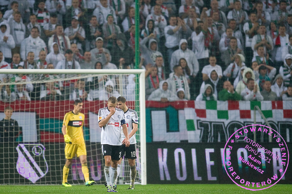 (C) Legia's Jakub Rzezniczak reacts after lost goal during the UEFA Europa League Group J football match between Legia Warsaw and Trabzonspor AS at Pepsi Arena Stadium in Warsaw on November 07, 2013.<br /> <br /> Poland, Warsaw, November 07, 2013<br /> <br /> Picture also available in RAW (NEF) or TIFF format on special request.<br /> <br /> For editorial use only. Any commercial or promotional use requires permission.<br /> <br /> Mandatory credit:<br /> Photo by &copy; Adam Nurkiewicz / Mediasport