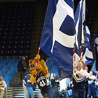The Nittany Lion mascot runs onto the court carrying a flag before the start of an NCAA basketball game in Unversity Park, Pa., Wedneday, February 27, 2013.