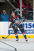 KELOWNA, CANADA - DECEMBER 5: Madison Bowey #4 of Kelowna Rockets passes the puck against the Prince George Cougars on December 5, 2014 at Prospera Place in Kelowna, British Columbia, Canada.  (Photo by Marissa Baecker/Shoot the Breeze)  *** Local Caption *** Madison Bowey;