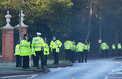 © Licensed to London News Pictures. 04/12/2019. Watford, UK. A line of police guard the gates to The Grove Hotel where NATO leaders are meeting. World leaders are attending a series of events over the two day NATO summit which will mark the 70th anniversary of the alliance of nations. Photo credit: Peter Macdiarmid/LNP