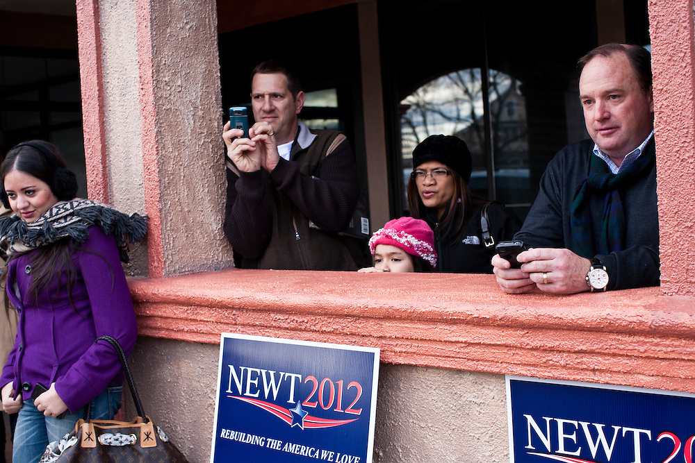 People watch an Occupy protest outside a town hall meeting with Republican presidential candidate Newt Gingrich at Don Quijote restaurant on Sunday, January 8, 2012 in Manchester, NH. Brendan Hoffman for the New York Times