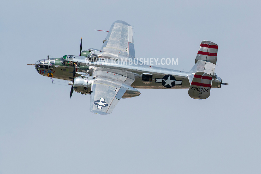 "New Windsor, New York - The World War II era B-25 Mitchell Bomber ""Panchito"" flies at the New York Air Show at Stewart International Airport on Aug. 29, 2015. ©Tom Bushey / The Image Works"