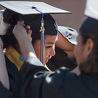 Christine Charley adjusts her cap before the graduation ceremony at Diné College in Tsalie Friday. Charley graduates from the school with a degree in Business Administration.