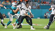 Aug 22, 2019; Miami Gardens, FL USA;  Jacksonville Jaguars quarterback Nick Foles (7) hands off the ball during an NFL preseason game at Hard Rock Stadium. The Dolphins beat the Jaguars 22-7. (Kim Hukari/Image of Sport)