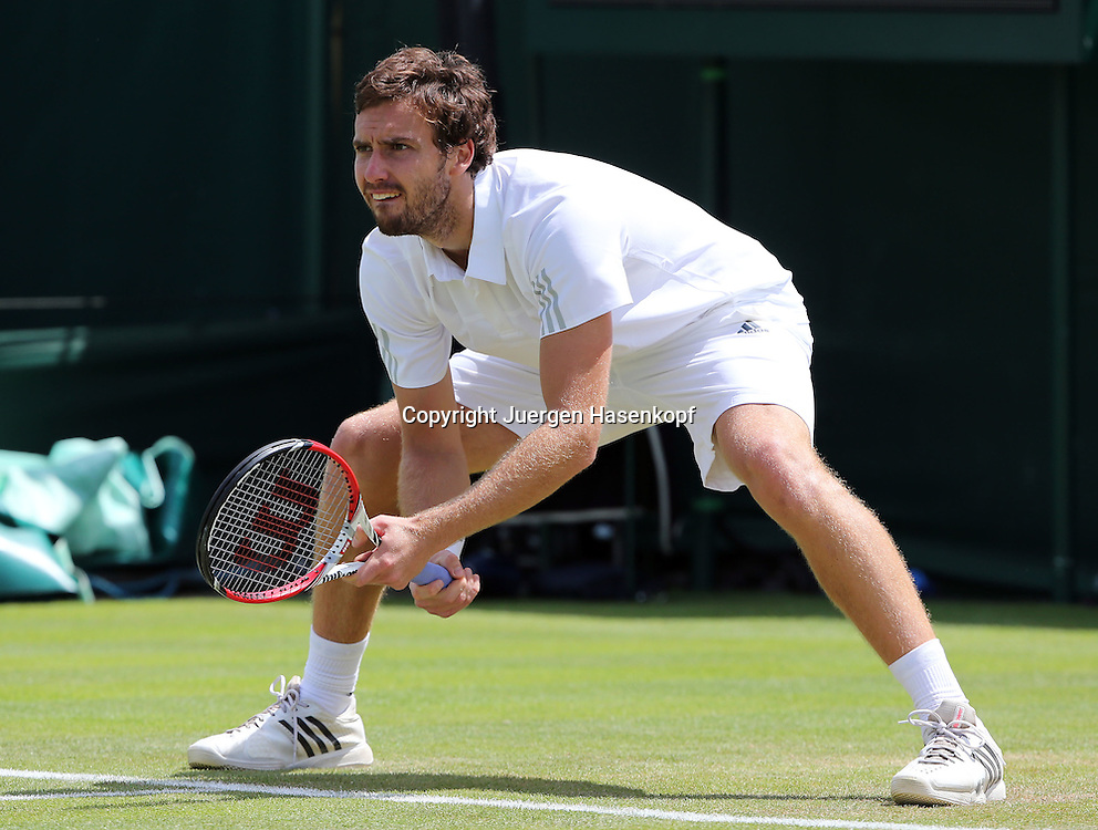 Wimbledon Championships 2014, AELTC,London,<br /> ITF Grand Slam Tennis Tournament,<br /> Ernests Gulbis (LAT),Aktion,Einzelbild,Ganzkoerper,Querformat,