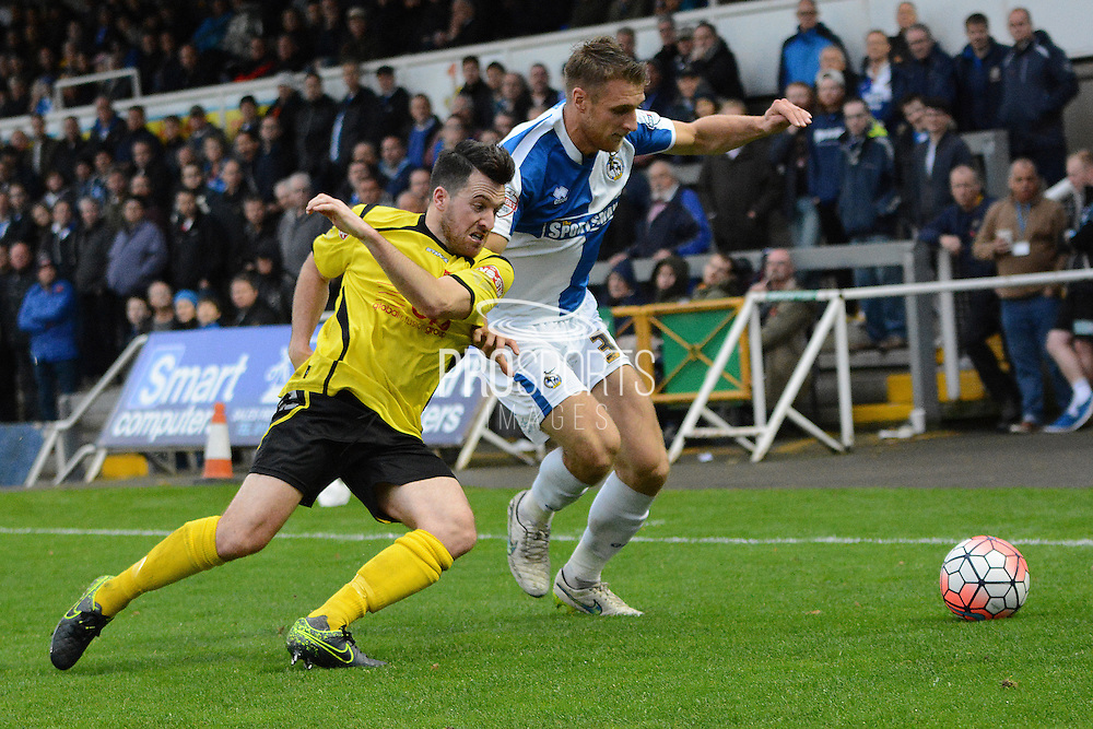 Bristol Rovers defender Lee Brown and Chesham United defender Ashley Smith battle for the ball during the The FA Cup match between Bristol Rovers and Chesham FC at the Memorial Stadium, Bristol, England on 8 November 2015. Photo by Alan Franklin.