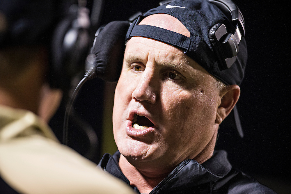 BENTONVILLE, AR, September 20, 2013:  Bentonville High School Tigers football game vs Euless Trinity, TX<br /> <br /> Head Coach Barry Lunney<br /> Defensive Line Coach Tony Cherico<br /> Wide Receivers Coach Rod Washington