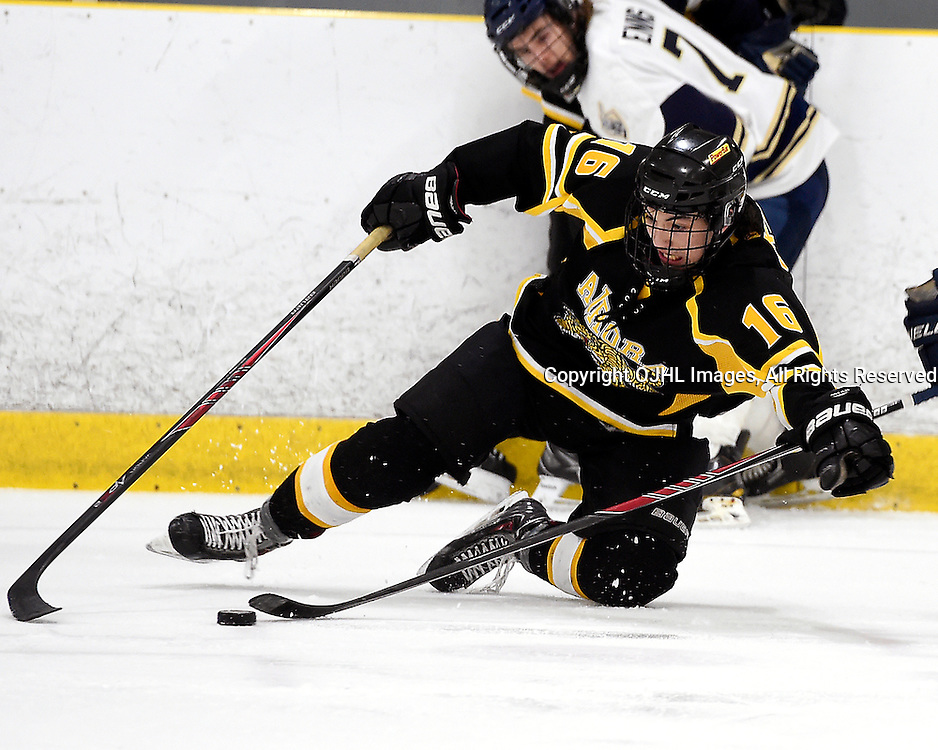 TORONTO, ON - Apr 13 : Ontario Junior Hockey League, Buckland Cup Championship Series between the Aurora Tigers and the Toronto Lakeshore Patriots, Dylan Sikura #16 of the Aurora Tigers battles for the puck during second period game action.<br /> (Photo by Andy Corneau / OJHL Images)