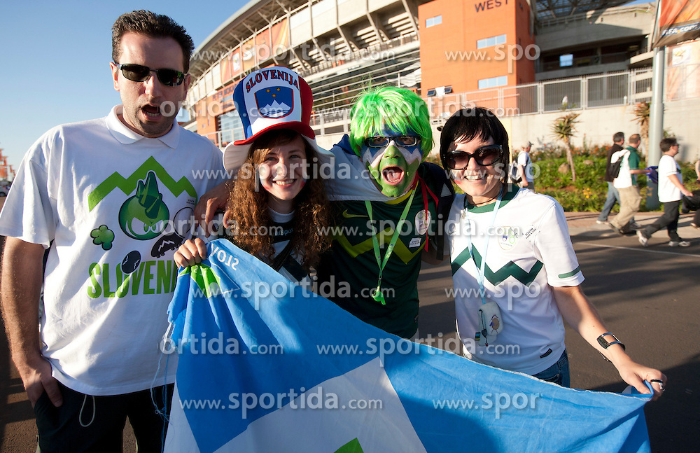 Fans of Slovenia celebrate after the Group C first round 2010 FIFA World Cup South Africa match between Algeria and Slovenia at Peter Mokaba Stadium on June 13, 2010 in Polokwane, South Africa.  Slovenia defeated Aleria 1-0. (Photo by Vid Ponikvar / Sportida)