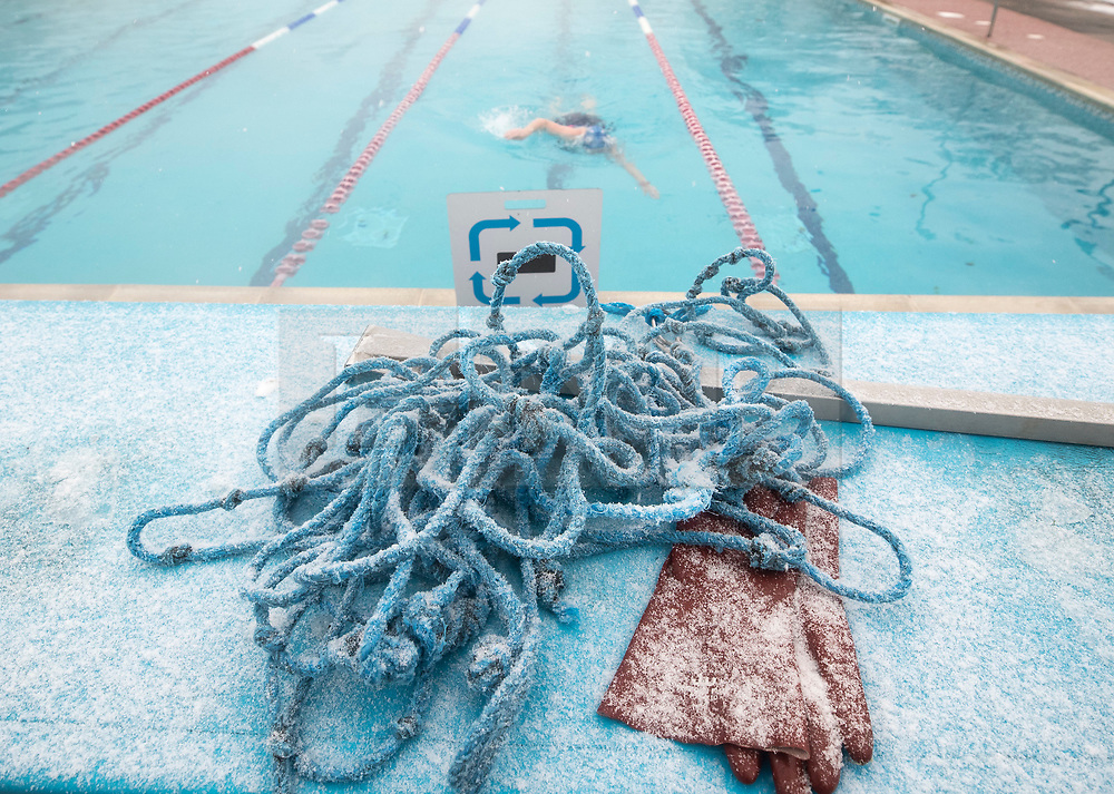 © Licensed to London News Pictures. 02/03/2018. London, UK. Frozen, iced up rope sits poolside as swimmers brave the cold and snow at Hampton outdoor heated pool in south west London. The 'Beast from the East' and Storm Emma have brought extreme cold, ice and heavy snow to the UK. Photo credit: Peter Macdiarmid/LNP