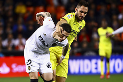January 26, 2019 - Valencia, Spain - Santi Mina of Valencia CF  (L) in action against Jaume Costa of Villarreal CF (R) during  spanish La Liga match between Valencia CF vs Villarreal CF at Mestalla Stadium on Jaunary  26, 2019. (Credit Image: © Jose Miguel Fernandez/NurPhoto via ZUMA Press)