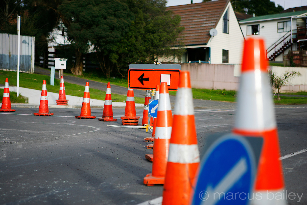 road diversion indicated by a diversion sign, traffic signs and road cones at Browns Bay, Auckland, New Zealand