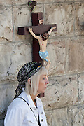 Israel, Jerusalem, Christian pilgrim with crucifix