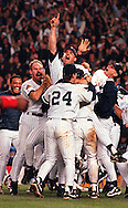 New York Yankees relief pitcher John Wetteland (center) celebrates with his teammates after their World Series victory over the Atlanta Braves in Yankee Stadium, Bronx, NY on Saturday, October 26, 1996. Wetland was named the series MVP as the Yankees defeated the Braves in 6 games to earn their 23rd. World Championship.  © Chet Gordon/The Journal News