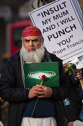 London, February 8th 2015. Muslims demonstrate outside Downing Street  to denounce the uncivilised expressionists reprinting of the cartoon image of the Holy Prophet Muhammad.