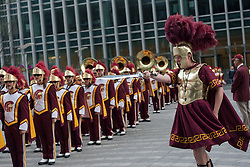 © licensed to London News Pictures. London, UK 17/05/2012. The Trojan Marching Band of the University of Southern California marching to the Canada Square Park for the first time performance in London, this evening (17/05/12). Photo credit: Tolga Akmen/LNP