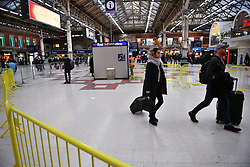 © Licensed to London News Pictures. 14/12/2016. London, UK. Passengers hoping to board a train, make their way through a mainly empty Victoria Station on 14 December 2016, as hundreds of thousands of rail passengers face a second day of a 3 day all-out strike in an escalating dispute over the role of conductors between Southern Rail and the RMT Union. Photo credit: Ben Cawthra/LNP