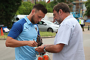 AFC Wimbledon defender Luke O'Neill signing autograph during the Pre-Season Friendly match between AFC Wimbledon and Bristol City at the Cherry Red Records Stadium, Kingston, England on 9 July 2019.