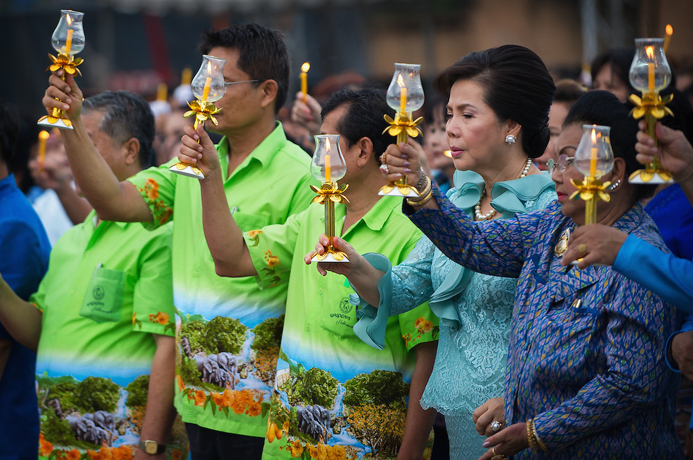 Celebrants light candles to honor the Queen as rural Thais celebrate HM Queen Sirikit's birthday in Nakhon Nayok, Thailand.