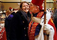 5 DEC. 2010 -- MILLSTADT, Ill. -- St. Nicholas (played by Millstadt, Ill. resident Mark Westhoff) places a Christmas kiss on the cheek of AFS exchange student Alina Pult of Freiburg, Germany during the 17th Annual Weihnachtsfest at St. James Catholic Church in Millstadt Sunday, Dec. 5, 2010. Pult, who is a student at Parkway South High School, was at the festival with host Marsha Clark of Des Peres, Mo. Image copyright © 2010 Sid Hastings.