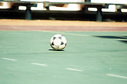 Children playing soccer in a school yard
