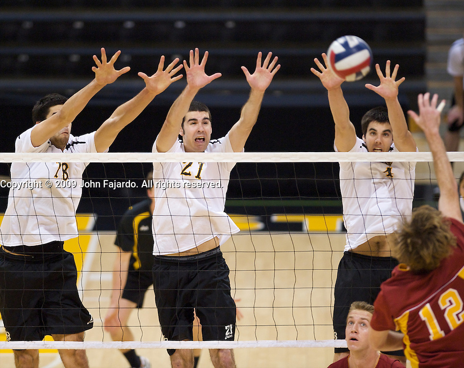 Long Beach State's Dean Bittner(18), Dan Alexander(21) and Tommy Pestolesi(4) attempt to block Sean Dennis(12) in Mountain Pacific Sports Federation play against USC at the Walter Pyramid, Long Beach CA, Wednesday, March 4, 2009.  Long Beach State loses in five sets, 31-29, 24-30, 30-23, 23-30, 13-15.