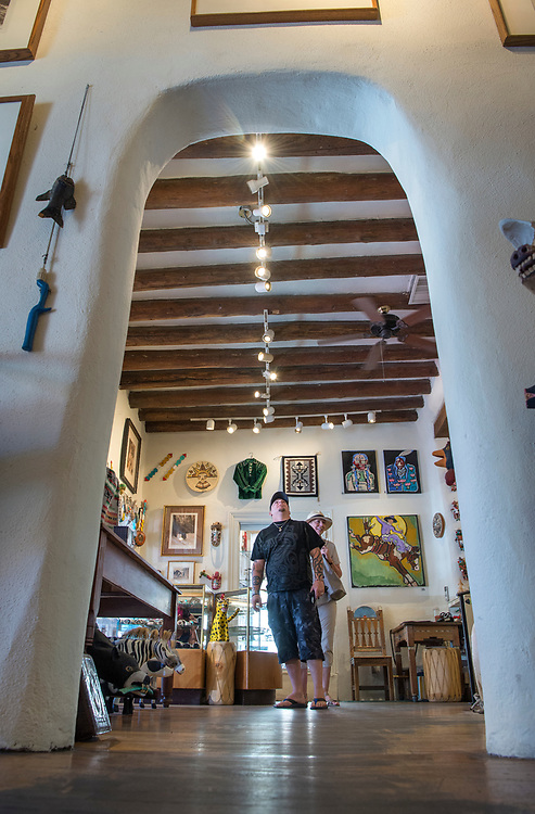 em072017b/jnorth/Zac Cox, grandson of the owners of The Rainbow Man on Palace Avenue, walks through the gallery in Santa Fe, Thursday July 20, 2017. Historians have been dating vigas and other materians in the old buildings along Palace. (Eddie Moore/Albuquerque Journal)