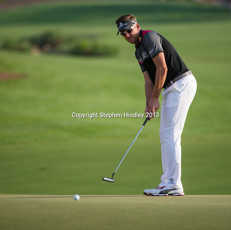 Ian Poulter of England putts on the 18th green during the second round of the DP World Tour Championship held at the Jumeirah Golf Estates in Dubai, United Arab Emirates, on Friday, November 15, 2013.  Photo by: Stephen Hindley/SPORTDXB