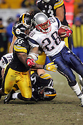 PITTSBURGH - JANUARY 23:  Though tackled on this play by Joey Porter #55 of the Pittsburgh Steelers, running back Corey Dillon #28 of the New England Patriots carried the ball 24 times for 73 yards and a touchdown against during the AFC Championship game at Heinz Field on January 23, 2005 in Pittsburgh, Pennsylvania. The Pats defeated the Steelers 41-27. ©Paul Anthony Spinelli  *** Local Caption *** Corey Dillon; Joey Porter