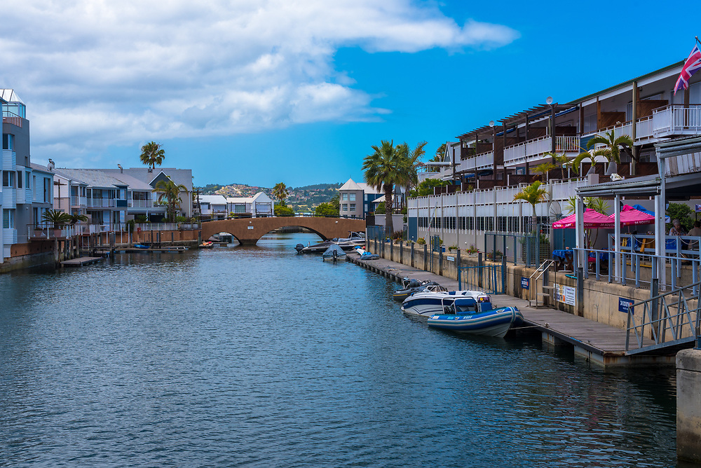Mossel Bay, South Africa--January 9, 2018--Boats are docked along a boardwalk  off Knysna Lagoon.  Editorial use only.