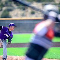 Miyamura Patriot Brandon Vidal (10) pitches to an  Aztec Tiger at Miyamura High School Thursday.