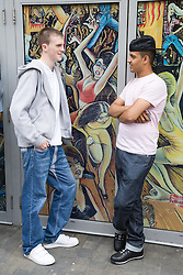 Two teenaged boys hanging around town,