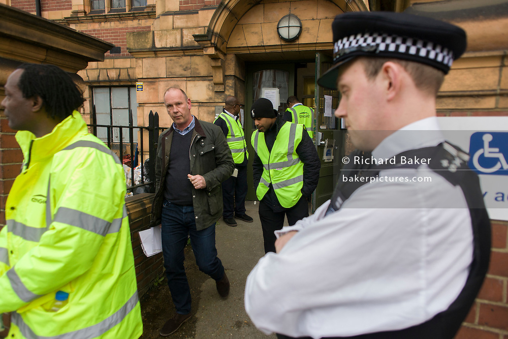 Council and court officials leave Carnegie Library in Herne Hill, south London while serving an eviction notice while occupiers remain inside the premises on day 9 of its occupation, 8th April 2016. The angry local community in the south London borough have occupied their important resource for learning and social hub for the weekend. After a long campaign by locals, Lambeth have gone ahead and closed the library's doors for the last time because they say, cuts to their budget mean millions must be saved. (Photo by Richard Baker / In Pictures via Getty Images).