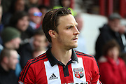 Brentford midfielder, Sam Saunders (7) looking on during the Sky Bet Championship match between Brentford and Fulham at Griffin Park, London, England on 30 April 2016. Photo by Matthew Redman.
